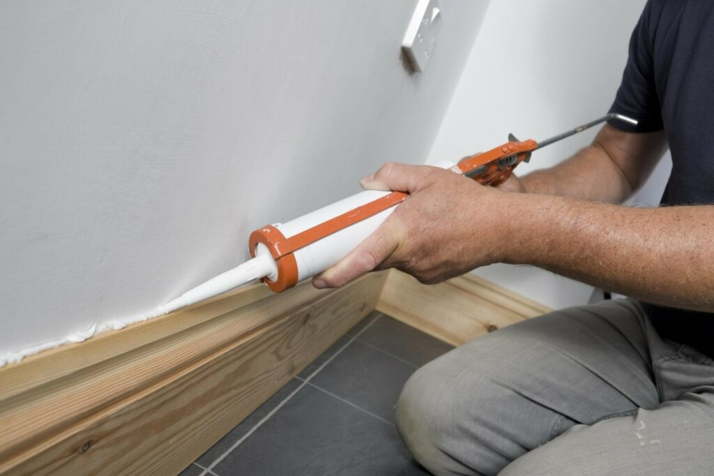 Apply Caulk to the Baseboards